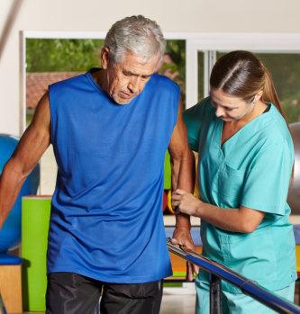 nurse assisting man in walking